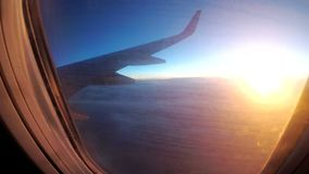View from the window of a passenger airplane during sunset on a landscape and horizon. BANGKOK, THAILAND, DECEMBER 10, 2017: View from the window of a passenger stock video footage