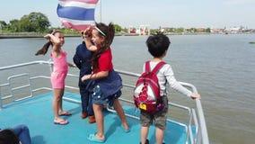Child are enjoying river boat ride in Bangkok river. stock video