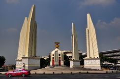 Bangkok, Thailand: The Democracy Monument. Thailand's uniquely designed Democracy Monument with its soaring sculpted wings stands in the middle of a large royalty free stock image