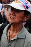 Bangkok/Thailand - 11 24 2012: Det thailändska folket protesterar mot gouvernmenten på den kungliga plazaen Arkivbild