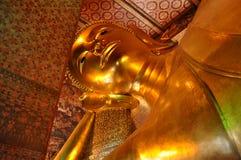 Bangkok, Thailand: Doende leunen Boedha van Pho van Wat Royalty-vrije Stock Fotografie