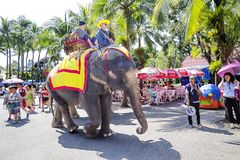 Bangkok, Thailand, Dusit Zoo. Elephant ride. During a walk in the zoo you can ride an elephant. Dusit Zoo is located in the Central part of Bangkok, considered royalty free stock image