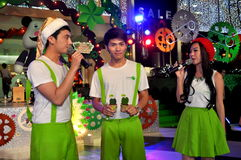 Bangkok, Thailand: Entertainers at Amarin Shopping Center. Trio of young Thai entertainers in front of the Amarin Shopping Centre Christmas decorations on stock image