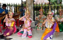 Bangkok, Thailand: Erawan Shrine Dancers. Local dance groups perform traditional Thai dances wearing classical costumes and Khong hats at the revered Erawan Royalty Free Stock Images