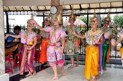 Bangkok, Thailand: Erawan Shrine Dancers. Local dance groups perform traditional Thai dances wearing elaborate classical costumes and Khong hats at the revered Royalty Free Stock Image