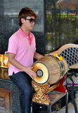 Bangkok, Thailand: Erawan Shrine Drummer Stock Image