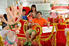 Bangkok, Thailand: Family on Christmas Sleigh Royalty Free Stock Images