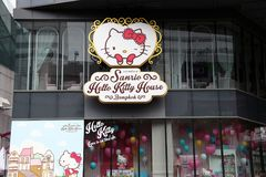 Logo sign beside the shop of Sanrio Hello Kitty coffee and bakery shop at Siam square shopping center. stock photo