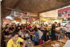 Bangkok, Thailand - Feb 11, 2018: Tourists enjoy shopping and eating Thai street food at Lad Mayom floating market. Bangkok, Thailand - Feb 11, 2018: Tourists Stock Photography