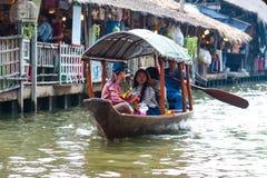 Bangkok, Thailand - Feb 11, 2018: Tourists enjoy traveling by tourist row boat on Lad Mayom canal. Bangkok, Thailand - Feb 11, 2018: Tourists enjoy traveling by stock photography