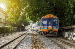Train Diesel railcar through neighborhoods of railroad community. BANGKOK, THAILAND - 23 Feb 2018 : Train Diesel railcar Daewoo departing from Bangkok Station Royalty Free Stock Photography