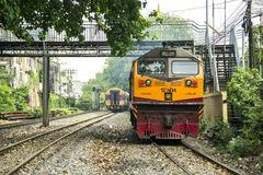 Train through neighborhoods of railroad community. BANGKOK, THAILAND - 23 Feb 2018 : Train To Bangkok Station. through environment have trees and neighborhoods Royalty Free Stock Photo