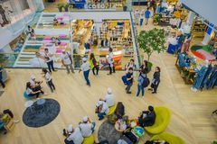 BANGKOK, THAILAND, FEBRUARY 02, 2018: Above view of unidentified people inside of Siam Paragon shopping mall in Bangkok. Thailand Royalty Free Stock Photo