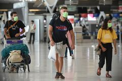 Air Travelers Wear Masks as a Precaution against Covid-19 Caused by Coronavirus