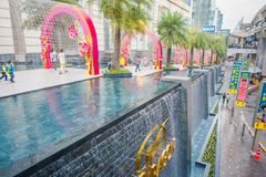 BANGKOK, THAILAND, FEBRUARY 08, 2018: Beautiful outdoor view of unidentified people walking at the enter of Siam mall. With a fountain and pink metallic Stock Image