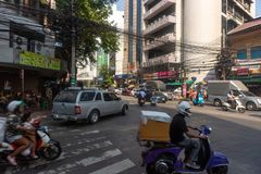 Bangkok, Thailand - February 14 2018 : Bike on the china town street .Twisted electrical wires on the streets of Bangkok.  royalty free stock photo