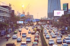 Traffic jam moves slowly along a busy road in city of Bangkok royalty free stock photography