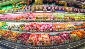BANGKOK, THAILAND - FEBRUARY 10:Foodland supermarket displays various species of refrigerated apples and other fruits for sale in royalty free stock image