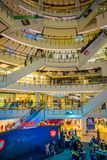 BANGKOK, THAILAND, FEBRUARY 02, 2018: Indoor view of unidentified people inside of Siam Paragon shopping mall in Bangkok. Thailand Royalty Free Stock Photography