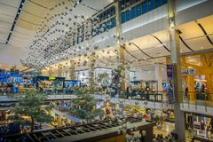 BANGKOK, THAILAND, FEBRUARY 02, 2018: Indoor view of unidentified people inside of Siam Paragon shopping mall with some. Hanging cristal balls from the rooftoop Royalty Free Stock Photos