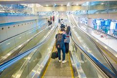 BANGKOK, THAILAND - FEBRUARY 01, 2018: Indoor view of unidentified people walking in electric stairs at Arrival Hall at Royalty Free Stock Images