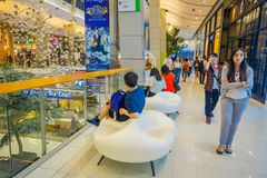 BANGKOK, THAILAND, FEBRUARY 02, 2018: Indoor view of unidentified people walking inside of Siam Paragon shopping mall in. Bangkok Thailand Stock Photos