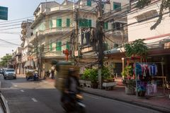 Bangkok, Thailand - February 14 2019 : Moving Bike with boxes on the china town street .Twisted electrical wires on the streets of. Bangkok royalty free stock photo