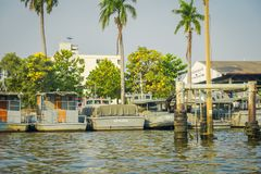 BANGKOK, THAILAND - FEBRUARY 09, 2018: Outdoor beautiful view of gray military ships in a riverside with some palms tree. Behind at yai canal or Khlong Bang royalty free stock photos