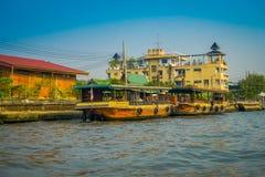 BANGKOK, THAILAND - FEBRUARY 09, 2018: Outdoor view of a rusted and old boat at riverside at yai canal or Khlong Bang Royalty Free Stock Image