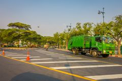 BANGKOK, THAILAND, FEBRUARY 08, 2018: Outdoor view of some public transport, green truck with other cars in a road of. The city in Bangkok, Thailand royalty free stock image