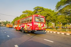 BANGKOK, THAILAND, FEBRUARY 08, 2018: Outdoor view of some public transport, red bus in a road of the city in Bangkok. Thailand royalty free stock image