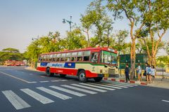 BANGKOK, THAILAND, FEBRUARY 08, 2018: Outdoor view of some public transport, red bus in a road of the city in Bangkok. Thailand royalty free stock photos