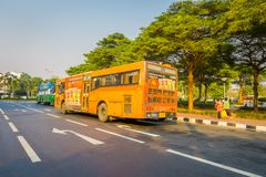 BANGKOK, THAILAND, FEBRUARY 08, 2018: Outdoor view of some public transport, yellow bus in a road of the city in Bangkok. Thailand Royalty Free Stock Photos