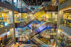 BANGKOK, THAILAND, FEBRUARY 02, 2018: Outdoor view of unidentified people in a electric stairs inside of Siam Paragon. Shopping mall in Bangkok Thailand Royalty Free Stock Image