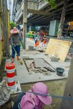BANGKOK, THAILAND, FEBRUARY 08, 2018: Outdoor view of unidentified people working in the street and tourists walk along Royalty Free Stock Image