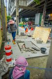 BANGKOK, THAILAND, FEBRUARY 08, 2018: Outdoor view of unidentified people working in the street and tourists walk along Stock Photography