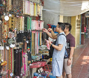 BANGKOK, THAILAND-FEBRUARY 04,2017 : People choose to purchase the necklace at the market of Sempeng Chinatown on Bangkok, Thailan Royalty Free Stock Photos