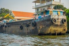 BANGKOK, THAILAND - FEBRUARY 09, 2018: Rusted a old boat at riverside with neumatics hanging, at yai canal or Khlong Stock Photos