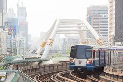 Bangkok Thailand : February 12, 2019 : Sky train or BTS and Office building under smog in Sathorn District, Bangkok stock photo