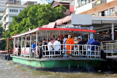 A lot of people are standing and sitting in the boat near to pier of the Chao Phraya River. Bangkok, Thailand - February 05th, 2017: A lot of people are Royalty Free Stock Photography