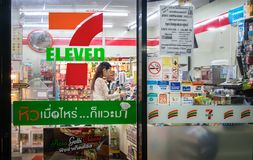 BANGKOK, THAILAND - FEBRUARY 25: An unidentified lady customer c. Hecks out at the service counter of a 7-Eleven convenient store in Bangkok on February 25, 2018 Royalty Free Stock Images