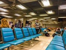 Bangkok,Thailand - February 21, 2017: Unidentified tired passenger is sleeping on the chairs in Suvarnabhumi international royalty free stock photo