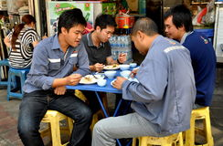 Bangkok, Thailand: Four Men Eating Lunch in Chinatown Royalty Free Stock Images