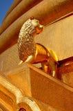 Bangkok, Thailand: Gilded Lion at Wat Boworniwet Stock Images