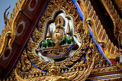 Bangkok, Thailand: Gilded Tympanum at Wat Hua Lamphong. A spectacular gilded tympanum with double green elephants, ornate designs, and a phoenix at Wat Hua Stock Photo