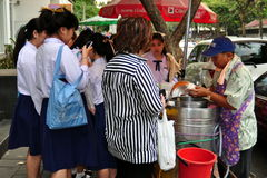 Bangkok, Thailand: Girls Buying Street Food Royalty Free Stock Photography