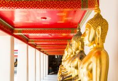 BANGKOK, THAILAND. Golden Buddha array in the temple of Wat Pho. Royalty Free Stock Photo