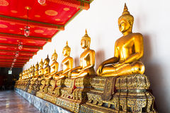 BANGKOK, THAILAND. Golden Buddha array in the temple of Wat Pho Stock Photos