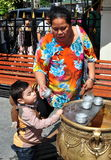 Bangkok, Thailand: Grandmother with Grandson at Shrine Royalty Free Stock Images