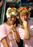 Bangkok, Thailand: Greeters at Shopping Mall. Two teenaged Thais wearing cute animal hats greet visitors to the sensational new Terminal 21 shopping mall on Stock Photos